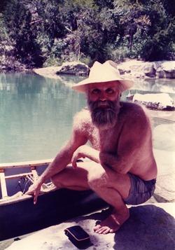 Wayne Gronquist with a canoe