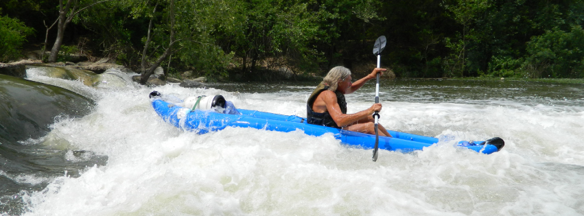 Kayaking through rapids